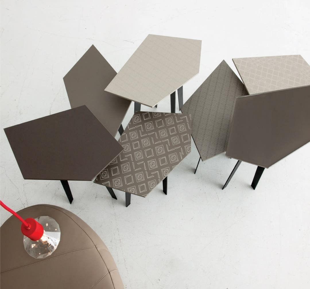 Na foto um mosaico formado pelas mesas Axo by SCAhellip