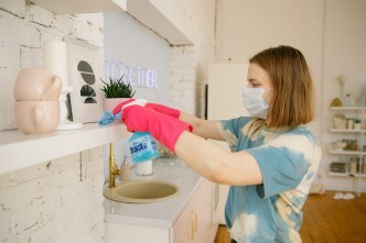 Canva - Woman Wearing Face Mask While Cleaning the Kitchen
